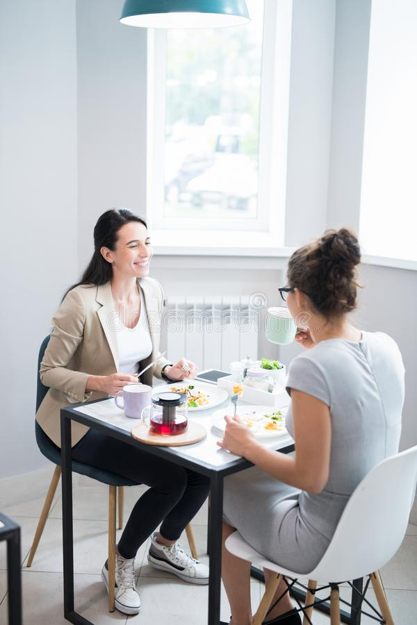 Two Women Enjoying Time in Cafe stock photos