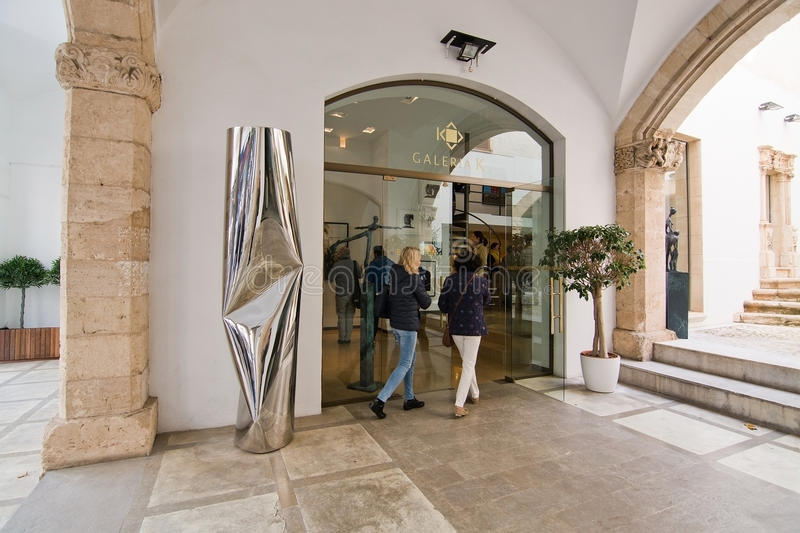 Two women enter Galeria K. PALMA DE MALLORCA, SPAIN - MARCH 25, 2017: Two women enter Galeria K at the Palma Art Brunch event on March 25, 2017 in Palma royalty free stock image