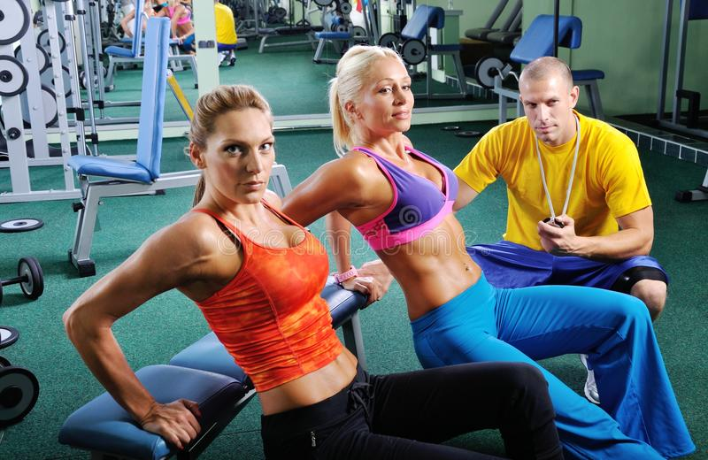 Download Two Women Exercise With Personal Fitness Trainer Stock Images - Image: 26646194