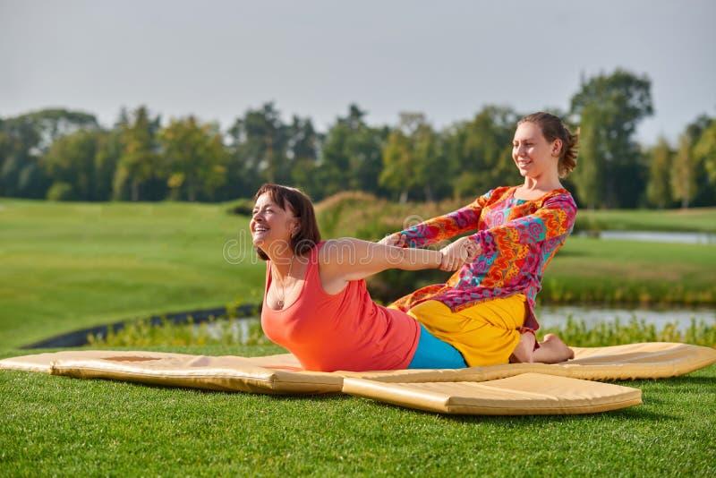 Two women exercising thai massage. stock photography
