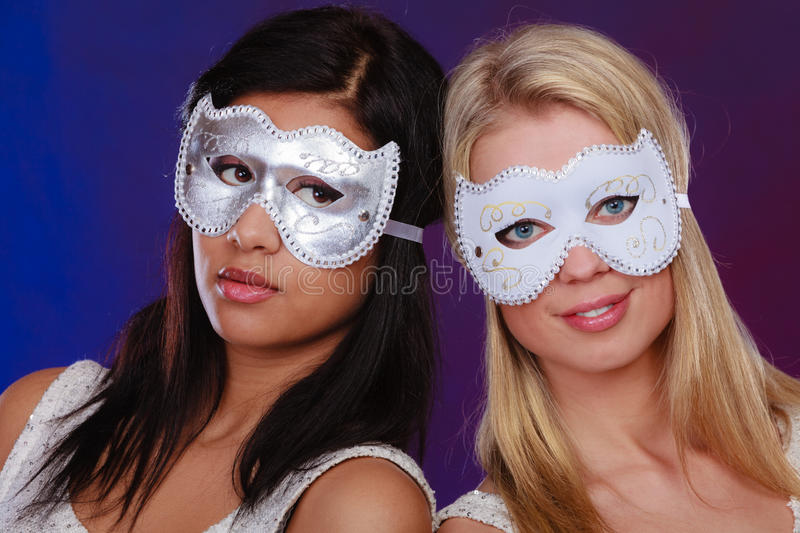 Two women face with carnival venetian masks royalty free stock photos