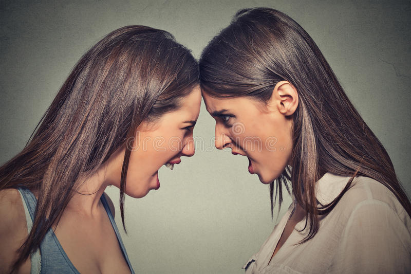 Two women fight. Angry women screaming looking at each other royalty free stock images