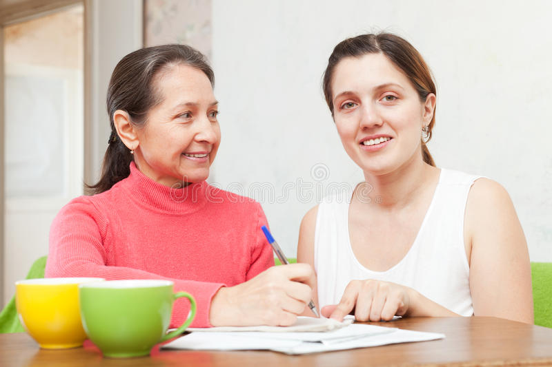 Two women fills in the questionnaire royalty free stock photo