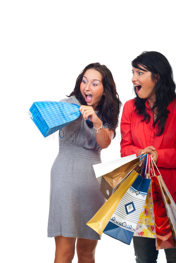 Two women friends having fun with a bag stock photography