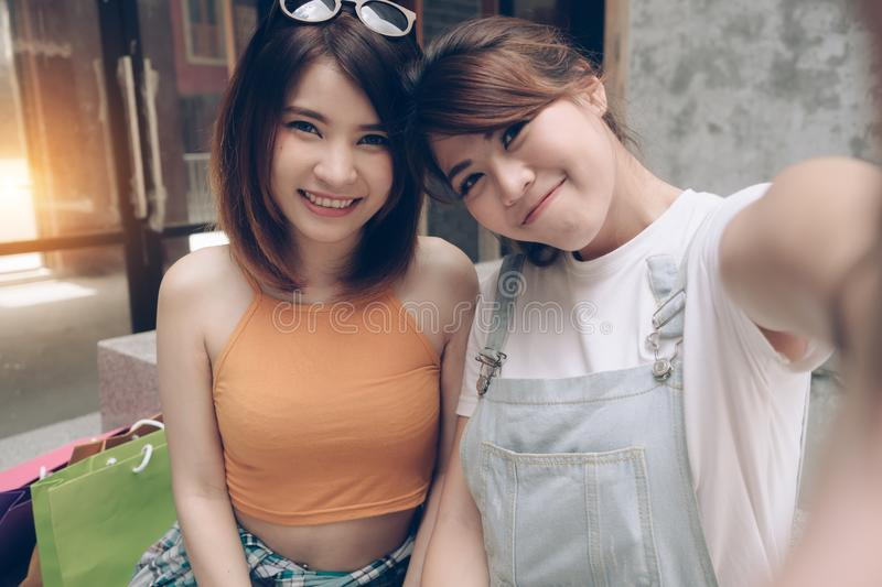 Two women friends selfie. Happy couple take photo together. Beau. Tiful fashion girls making self photo having fun together on summer day stock photos