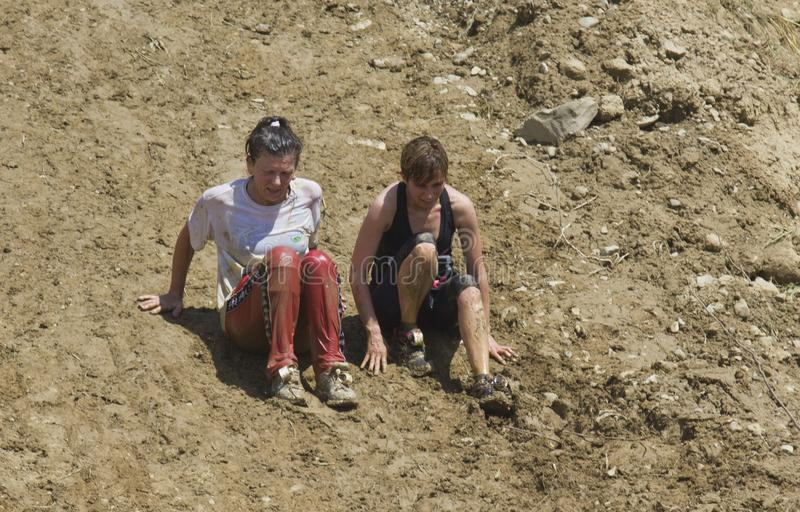 Two women going down on a steep slope stock photos