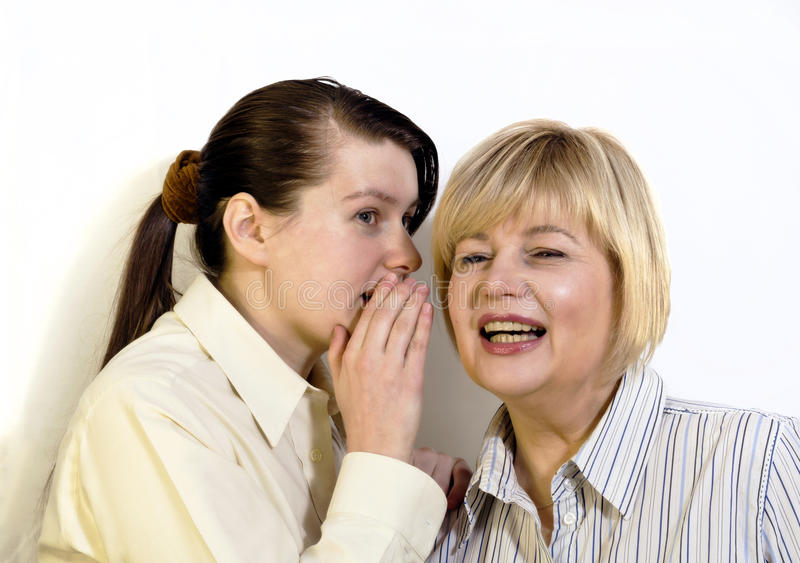 Two women gossiping. And discussing hot news stock images
