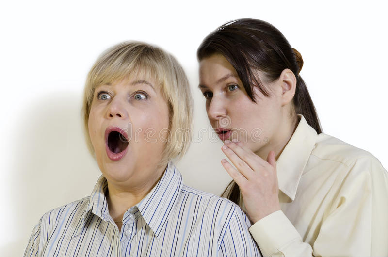 Two women gossiping. And discussing hot news royalty free stock photos