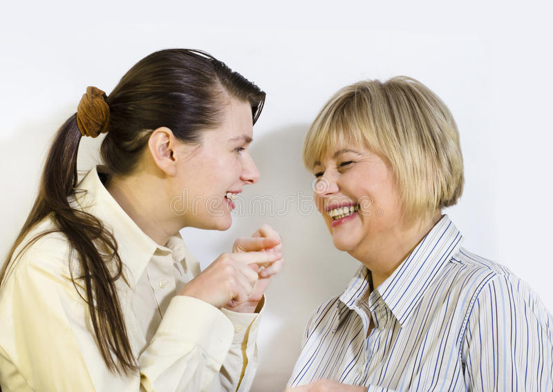 Two women gossiping. And discussing hot news royalty free stock photo