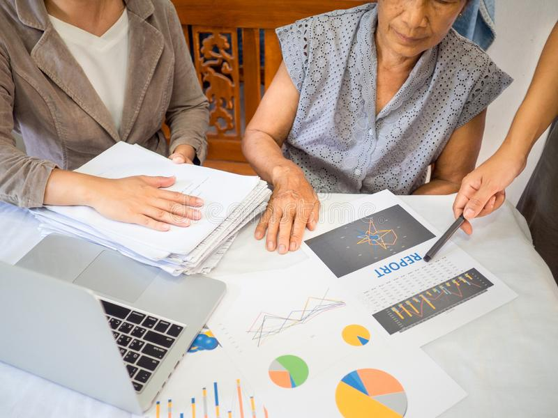 Two women have report discuss and analyzed the chart with old woman, set targets for new management success for home business royalty free stock photography