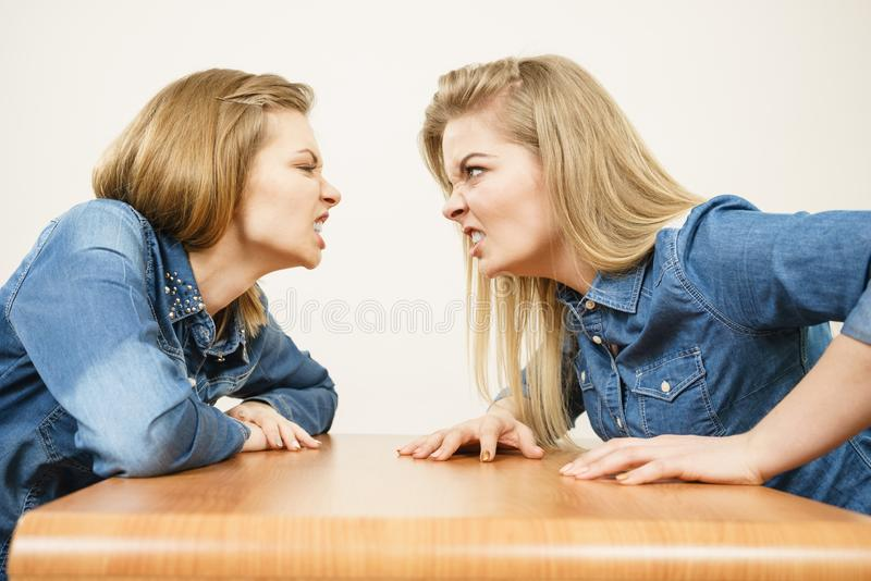 Two women having argue fight. Two women having argue mocking up being mad at each other. Female telling off, ignorance concept stock images