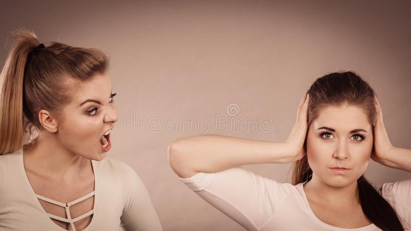 Two women having argue. Fight being mad at each other. Female telling off, ignorance concept stock images