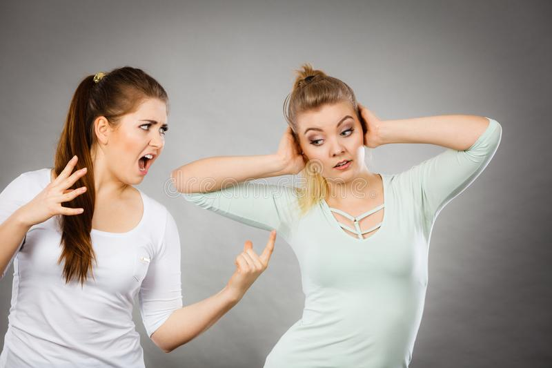Two women having argue. Fight being mad at each other. Female telling off, ignorance concept royalty free stock photos