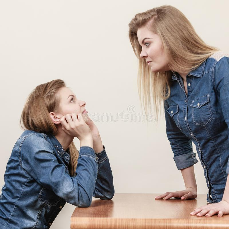 Two women having argue. Mocking up being mad at each other. Female telling off, ignorance concept stock images