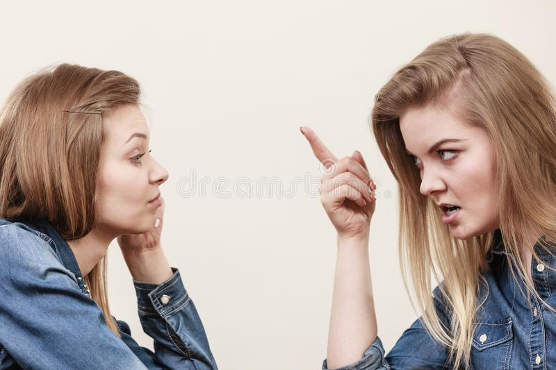 Two women having argue. Mocking up being mad at each other. Female telling off, ignorance concept stock photos