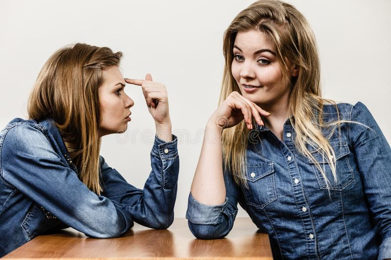 Two women having argue. Mocking up being mad at each other. Female telling off, ignorance concept royalty free stock photography