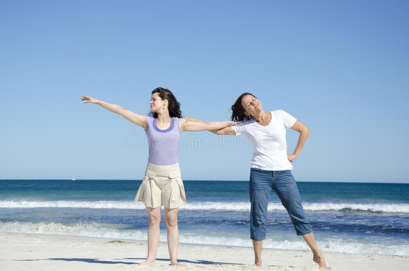 Two women having fun at the beach stock photo