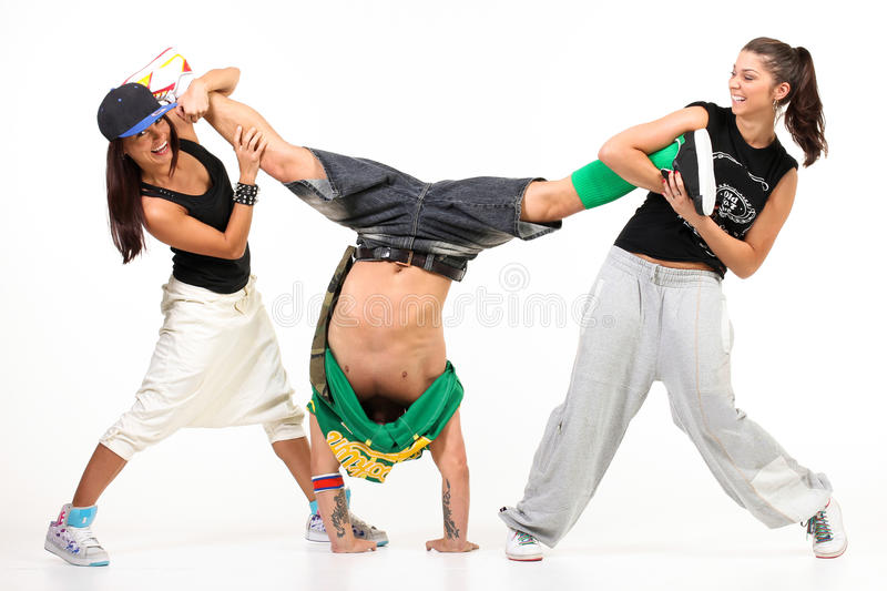 Two women having fun holding a man. Two women having fun holding a men in handstand royalty free stock images