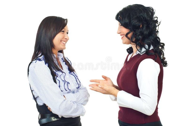 Two women having happy conversation stock images