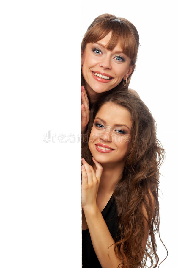 Two women hold in their hands clean poster. Isolated background stock image