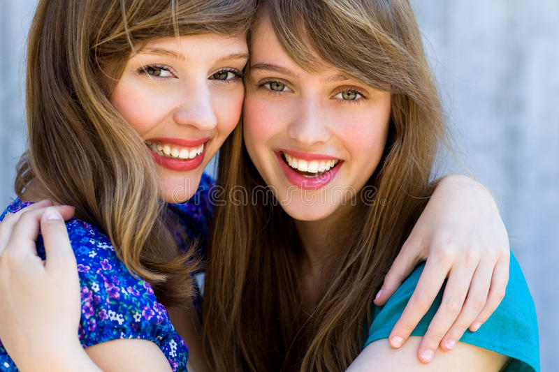 Two women hugging and smiling stock photo