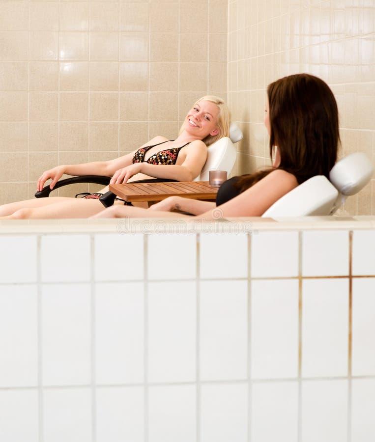 Download Two Women Beside Indoor Pool Stock Image - Image of brunette, laugh: 20072525