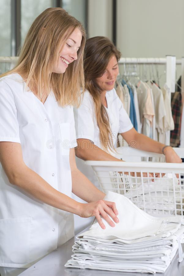 Two women laundress at work stock image