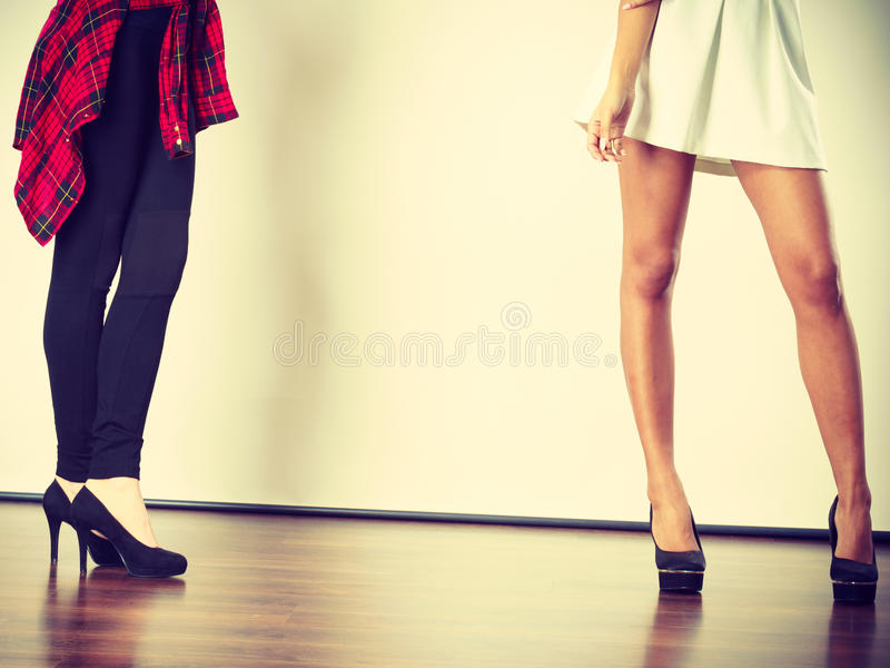Two women legs presenting high heels. Fashion, clothes, clothing accessories, trendy outfits concept. Two women legs presenting high heels royalty free stock images