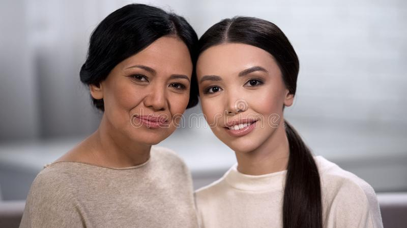 Two women looking into camera, family love, healthy skin regardless of age royalty free stock photos