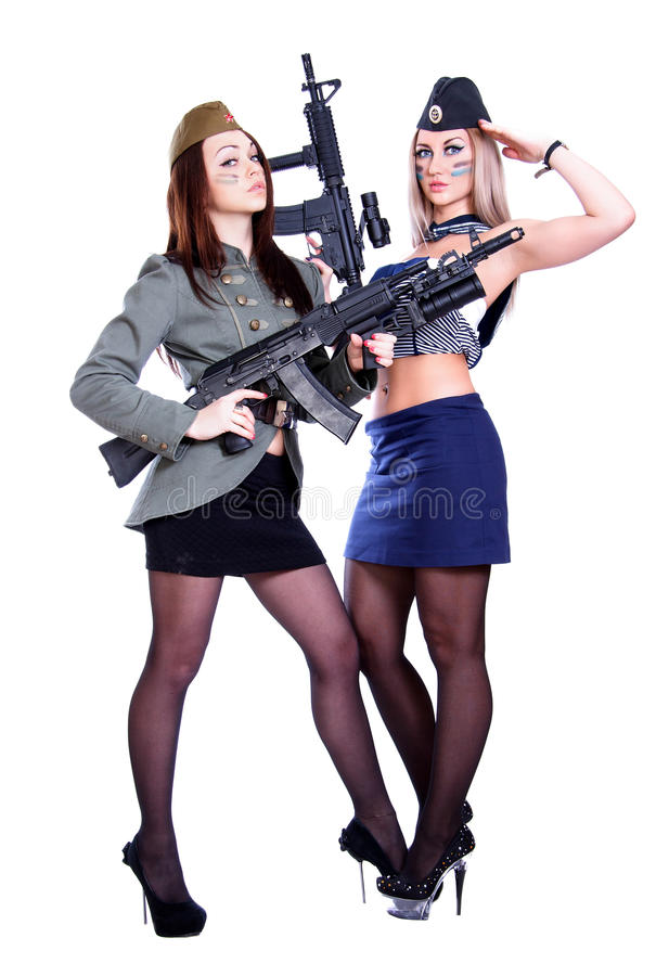 Two women in the marine and the military uniforms with the assault rifles. Isolated over white background royalty free stock images