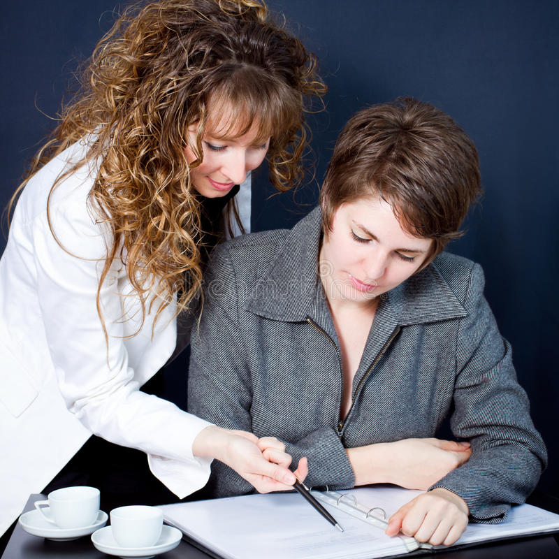 Two women in a meeting. Two business women in a meeting royalty free stock photos