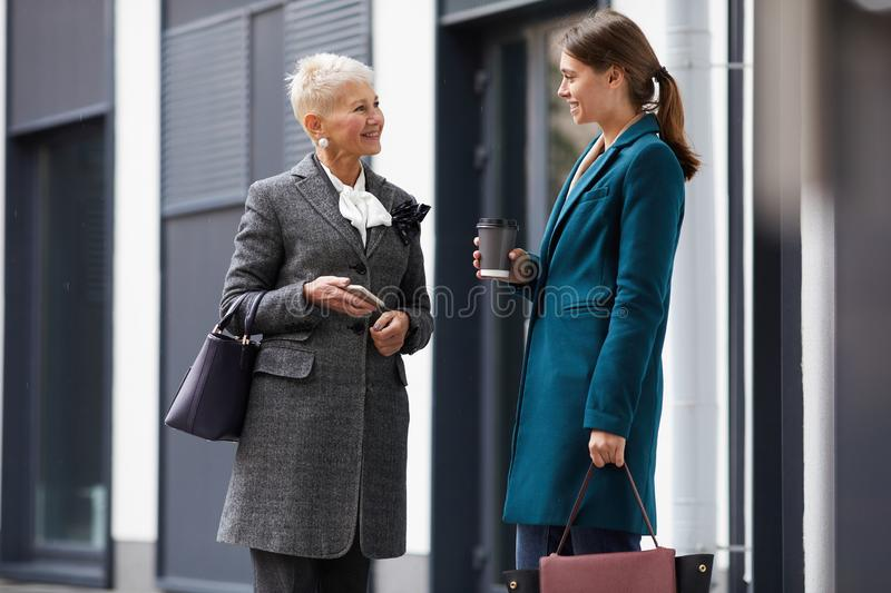 Two women meeting in the city royalty free stock images