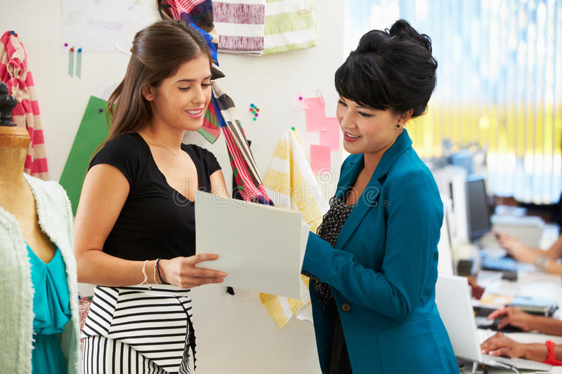 Two Women Meeting In Fashion Design Studio royalty free stock images