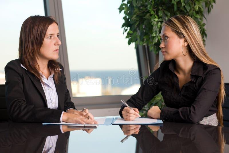 Two women negotiating stock photo
