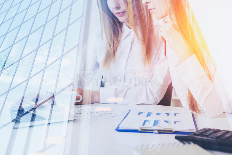 Two women in office and skyscraper stock photos