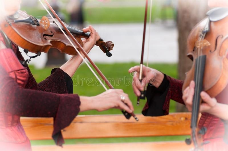Two women practicing violin. Close-up stock image