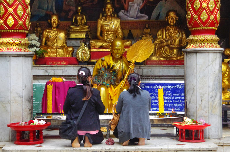 Two - women - prayers - Thailand;. Morning prayers are an essential part of Buddhist practice stock photography