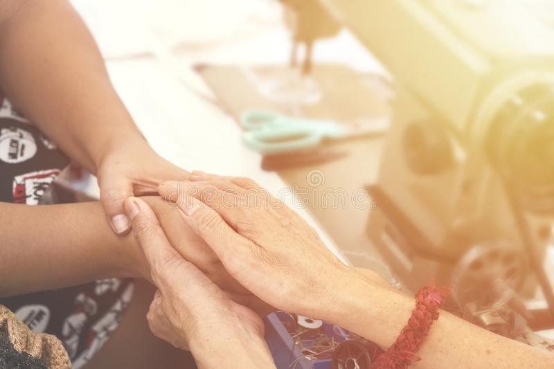 Two women praying together and encourage each other. color filter added. royalty free stock images