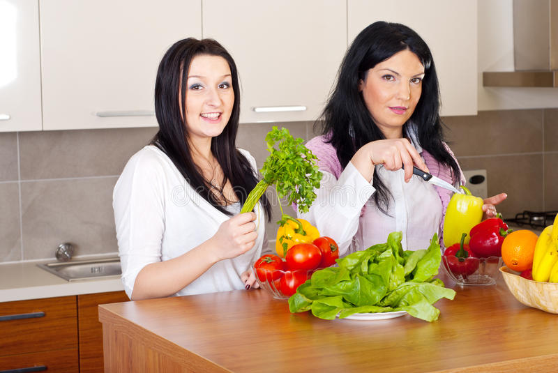 Two women prepare the dinner stock images