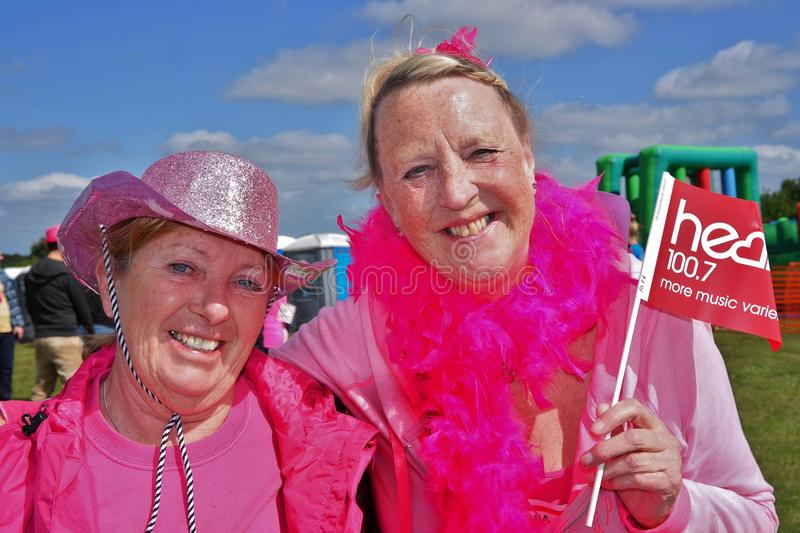Two women at Race for Life event royalty free stock photo