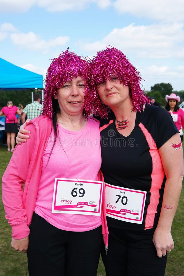 Two women at Race For Life event royalty free stock photography