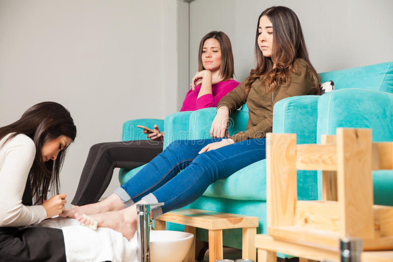 Two women relaxing at a nail spa royalty free stock photography
