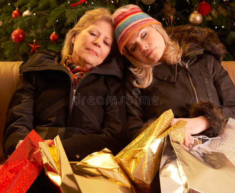 Two Women Returning After Christmas Shopping Trip
