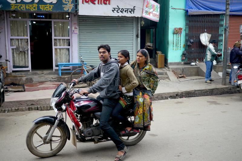 6 March 2015 - Bihar, India : In rural India families use motorbikes for transport. Two women riding on a motorbike in rural India stock images