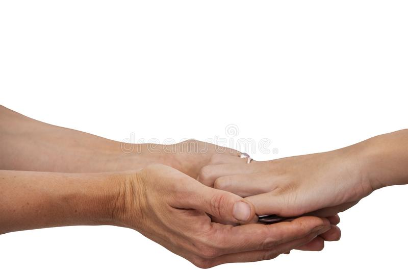 Two womens hands reaching from either side exchanging coins - paying for something - isolated - room for copy stock images