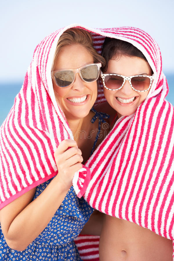 Download Two Women Sheltering From Sun On Beach Holiday Stock Image - Image: 27202371