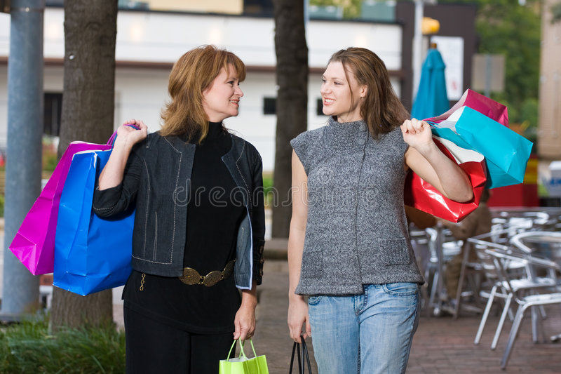 Two Women Shopping royalty free stock photos