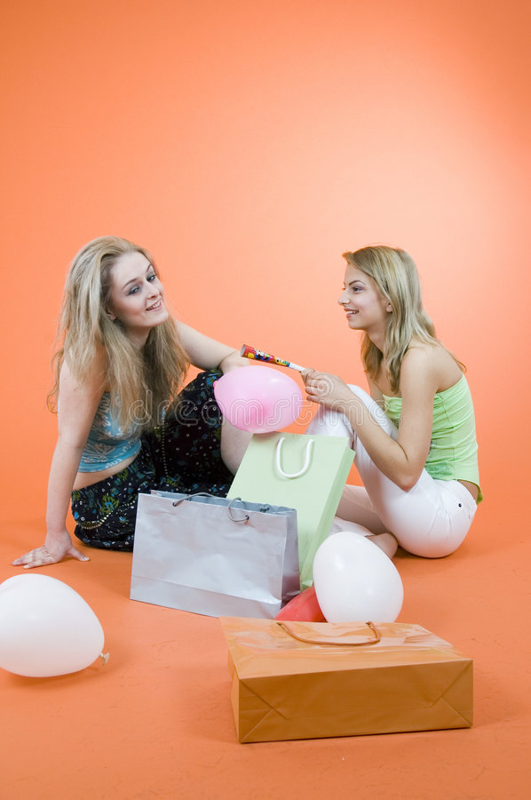 Download Two Women With Shopping Bags And Balloons Stock Photo - Image: 1343316
