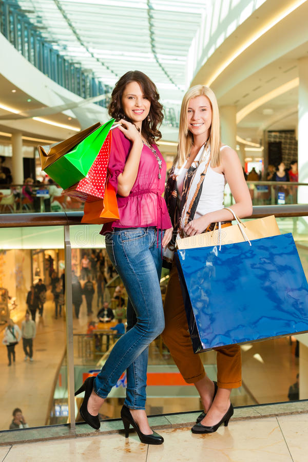 Download Two Women Shopping With Bags In Mall Stock Image - Image: 26486985