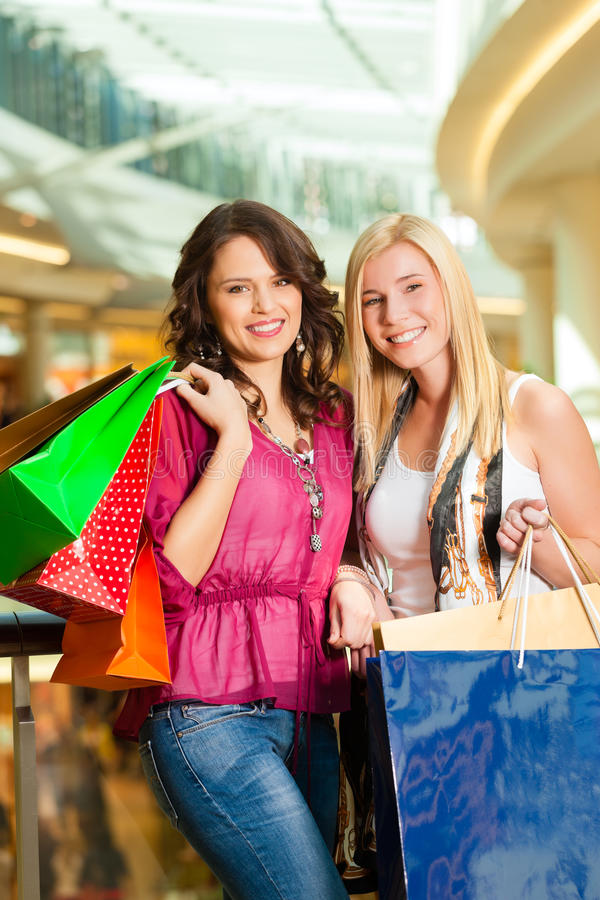 Download Two Women Shopping With Bags In Mall Stock Photo - Image: 29150784